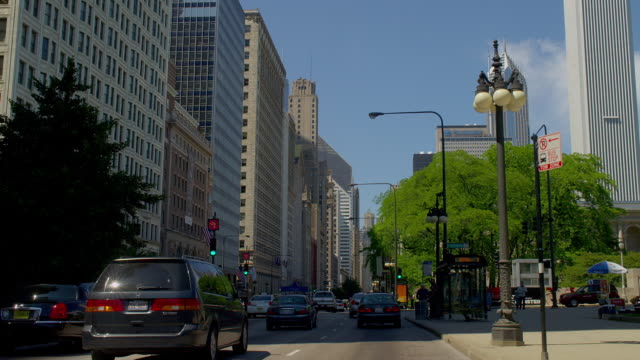 Traffic moves along a busy Michigan Avenue in downtown Chicago, Illinois.