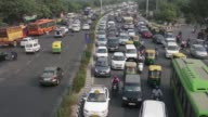 Traffic moves along a highway during morning rush hour in Delhi India on Oct 29 2015