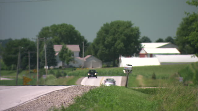 Traffic moves along a road in rural Iowa.