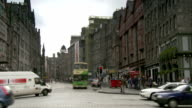 Traffic moves along a street in Edinburgh near the Royal Mile. Available in HD.
