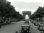 Traffic moves along the Champs Elysees towards the Arc de Triomphe