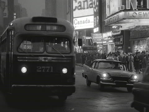 Traffic moves along Times Square in New York 1959