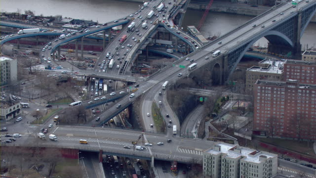 Traffic moves over exit ramps and overpasses in the Morris Heights neighborhood of the Bronx in New York City.