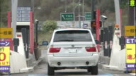 Traffic moves through the ETC toll-collection gate at the Nikko Interchange of the Nikko-Utsunomiya Road in Tochigi Prefecture, Japan.