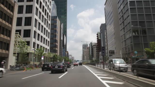MS POV Traffic moving in neighborhood of Aoyama / Tokyo, Japan