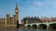 WS T/L Traffic moving on bridge in front of big ben tower / London, United Kingdom