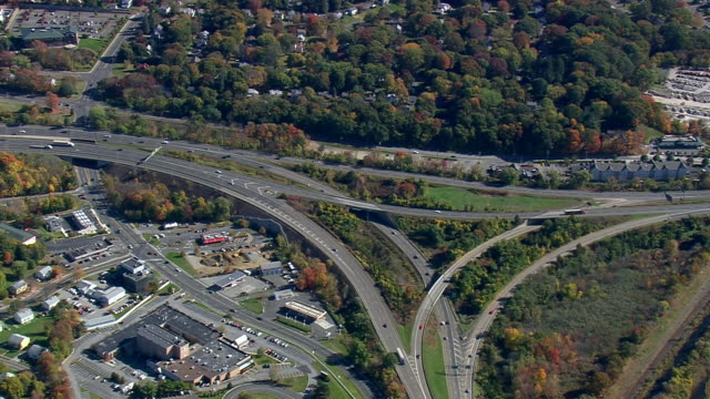 MS AERIAL TS Traffic moving on highway in Danbury city / Connecticut, United States