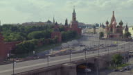 WS Traffic moving on road in front of Spaakaya Clock tower and St. Basil visible with Red Square
