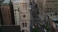 WS Traffic moving past the Con Ed clock tower / New York, New York, United States