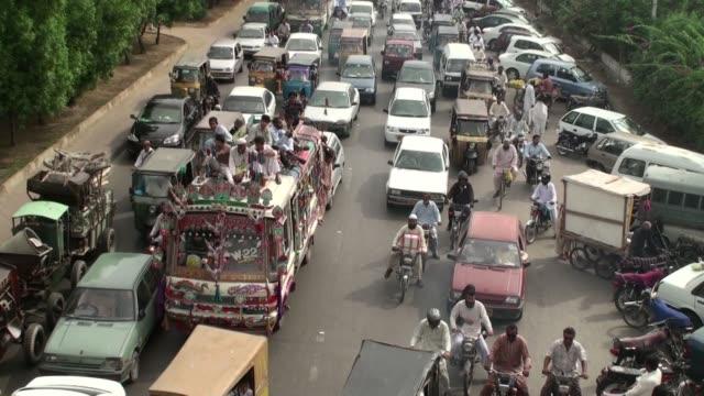 Traffic moving slow at Old Sabzi Mandi road in Karachi Pakistan