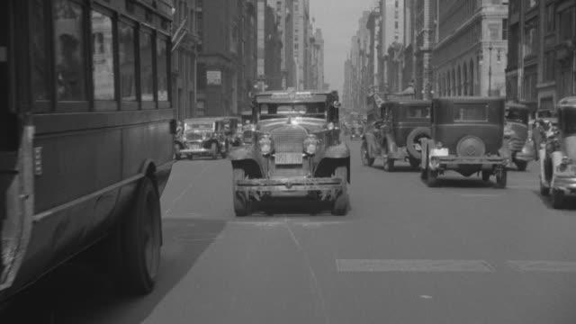 MS POV Traffic moving straight on street of south Harlem at New York