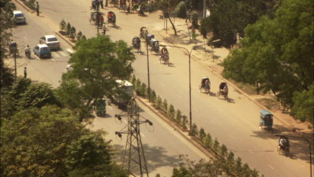 MS, HA, Traffic of rickshaws and cars on street, Dhaka, Bangladesh