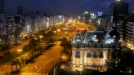 T/L, WS, HA, Traffic on Avenida 9 de Julio at French Embassy, day to night, Buenos Aires, Argentina