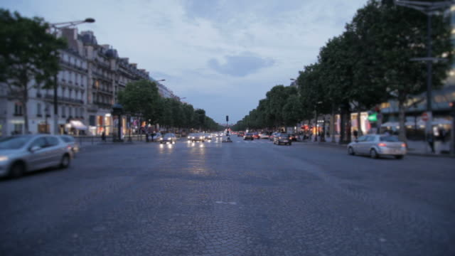 Traffic on Avenue des Champs-Elysees at twilight, Paris, France