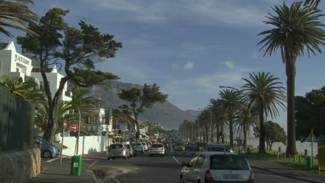 WS Traffic on Camps Bay boulevard with Twelve Apostles mountain in background, Cape Town, Western Cape, South Africa