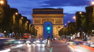 T/L WS Traffic on Champs-Elysees at dusk, Arc De Triomphe in background / Paris, France