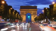 T/L WS ZO Traffic on Champs-Elysees at dusk, Arc De Triomphe in background / Paris, France