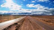 WS  T/L Traffic on dual lane highway through barren desert  / CALIFORNIA,United States