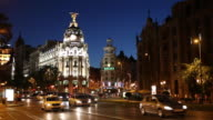 WS Traffic on Gran Via and Metropolis Building illuminated at night / Madrid, Spain