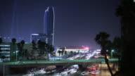 WS Traffic on highway and skyscraper illuminated ay night / Los Angeles, California, USA