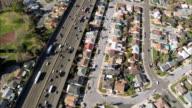 AERIAL Traffic on highway in San Francisco suburbs / California, USA