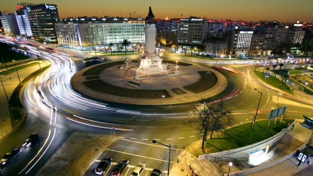 T/L WS HA Traffic on Marquis of Pombal Square at night, Lisbon, Portugal