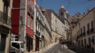 WS Traffic on narrow old town street / Lisbon, Portugal
