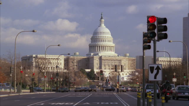 MS Traffic on Pennsylvania Avenue with Capitol building in background / Washington DC, United States