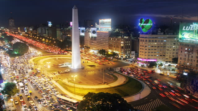 T/L, WS, HA, Traffic on Plaza de la Republica  with obelisk, day to night, Buenos Aires, Argentina
