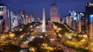 T/L, WS, HA, Traffic on Plaza de la Republica  with obelisk, day to night, Buenos Aires, Argentina