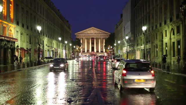 WS Traffic on street at night, La Madeleine church in background / Paris, France