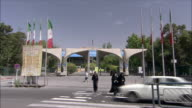 MS Traffic on street in front of University building, Tehran, Iran