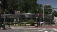 WS Traffic on street intersection, Mirage Diner in background / New Rochelle, New York, USA