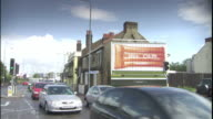 Traffic passes a digital billboard in London.