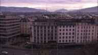 Traffic passes a hotel in Geneva, Switzerland.