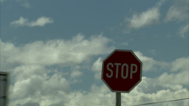 Traffic passes a stop sign.