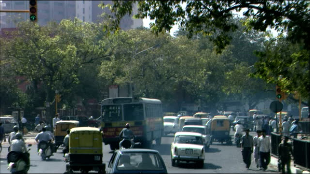 Traffic passes along busy road, Delhi