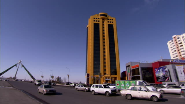 Traffic passes below the Astana Tower in Kazakhstan. Available in HD.