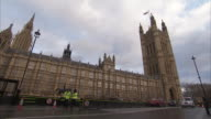 Traffic passes by the House of Parliament. Available in HD.