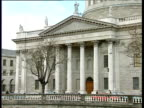 Traffic passes Four Courts building