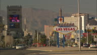 Traffic passes the iconic 'Welcome to Fabulous Las Vegas' sign in Nevada.