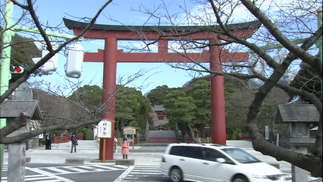 Traffic passes the Torii Gate in front of  the Tsurugaoka Hachimangu Shrine.