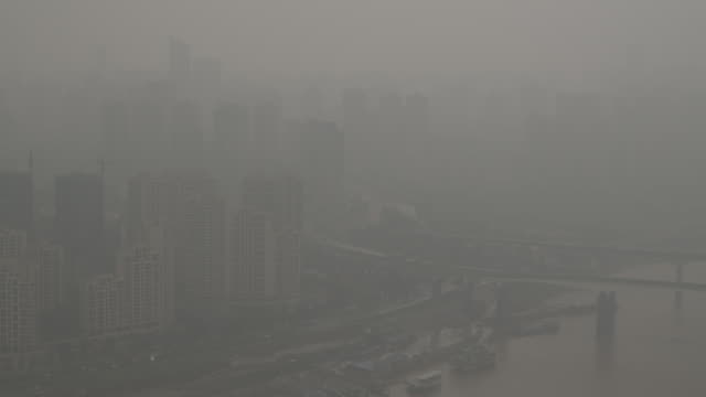 Traffic passes through heavy smog in the city of Chongqing.