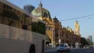 MS Traffic passing in front of flinders street station / Melbourne, Victoria, Australia
