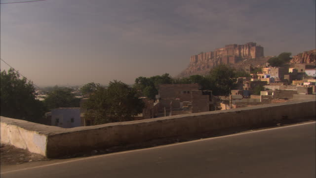 Traffic passing in front of Mehrangarh Fort. Available in HD.