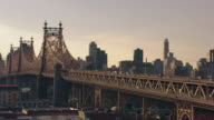 PAN WS Traffic passing over the Queensboro Bridge at dusk / Queens, New York, United States