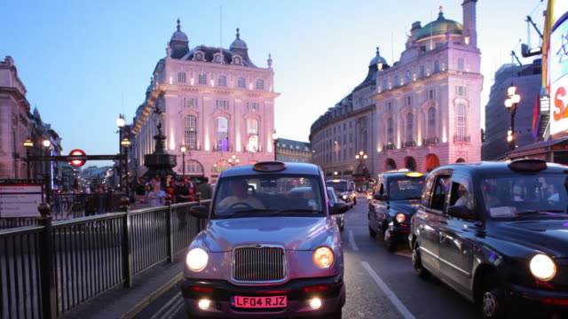 WS POV Traffic past Piccadilly Circus and down Haymarket Taxis and buses London Summer evening / London, UK