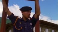 Traffic policeman in uniform and white gloves directs traffic, Thimphu, Bhutan Available in HD.