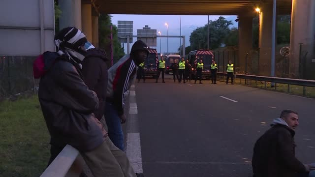 Traffic through the Channel Tunnel connecting Britain and France was suspended early Saturday after around 100 migrants entered the tunnel complex...