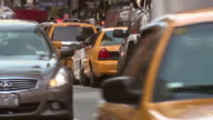 Traffic travels north and south during rush hour on a busy Manhattan work day.